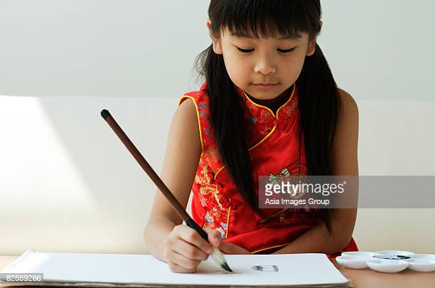 Young girl practicing calligraphy