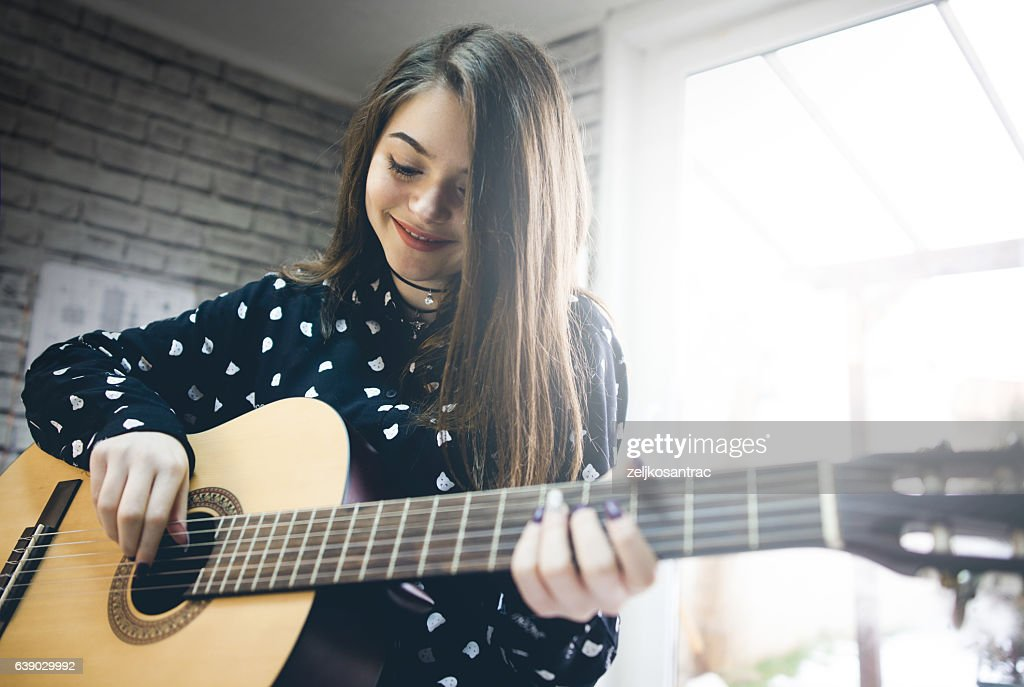 Young girl  practicing guitar. : Foto stock