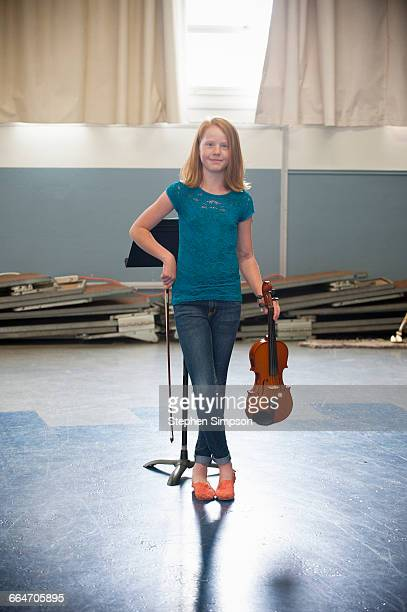 young girl practicing her violin - leanincollection stock pictures, royalty-free photos & images