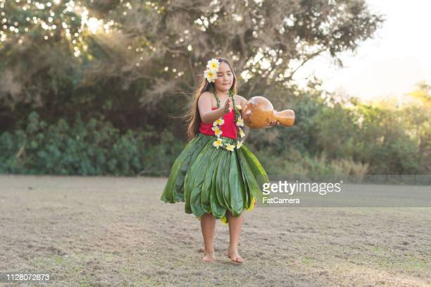 young girl practicing hula outside - hula dancer stock pictures, royalty-free photos & images