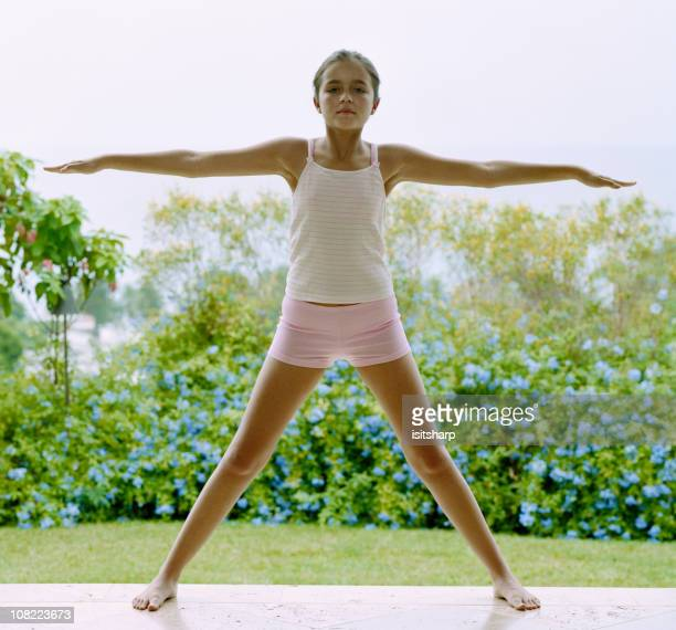 young girl practising yoga - legs apart stock photos and pictures