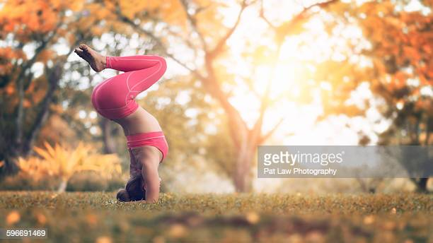 young girl practising yoga - yoga pants stock photos and pictures