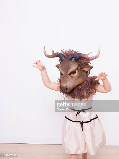 Young girl prancing around, wearing a deer mask