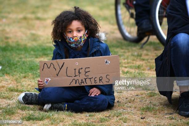 Young girl prepares for the Take The Knee demonstration in solidarity with Black Lives Matter in Windrush Square, Brixton, south west London on June...