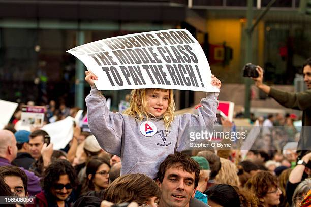 Young girl protesting for a better future in Foley Square yesterday. As 20,000 people marched on Wall Street yesterday Herman Cain, Republican...