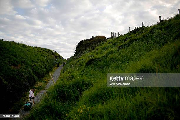 A young girl pulls her wagon up a path on the cliffs overlooking Omaha Beach June 2 2014 in Vierville France June 6th is the 70th anniversary of the...
