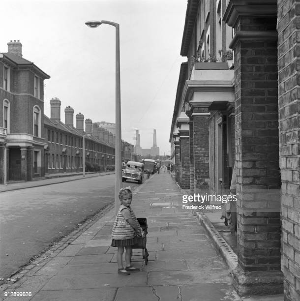 Young girl pushing pram London Street Scene Battersea Power Station circa 1960