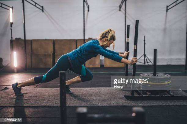 young girl pushing weights - circuit training stock photos and pictures