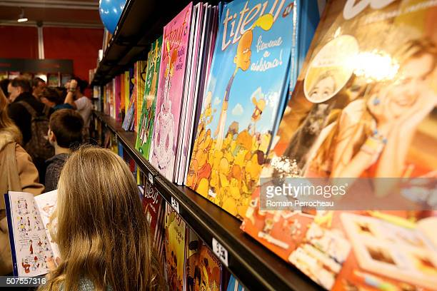 A young girl read a comic book during Angouleme 41st International Cartoonists Festival opening on January 30 2016 in Angouleme France