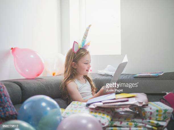 young girl reading birthday card - birthday card stock pictures, royalty-free photos & images