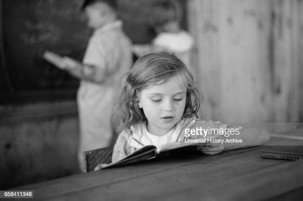 Young Girl Reading Book in Classroom, Cumberland Mountain Farms, near Scottsboro, Alabama, USA, Carl Mydans for U.S. Resettlement Administration,...