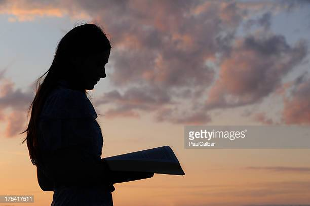 young girl reading - praying stock pictures, royalty-free photos & images