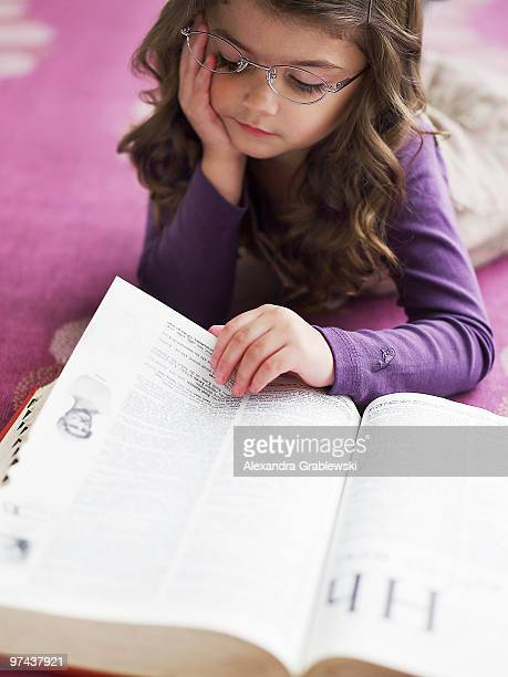Young Girl Reading the Dictionary