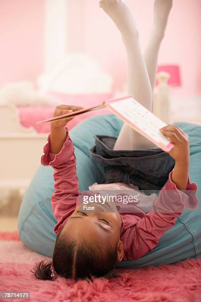 Young Girl Reading Upside Down