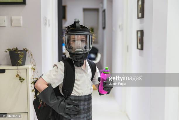 young girl ready for school in full face mask and gloves - school uniform stock pictures, royalty-free photos & images