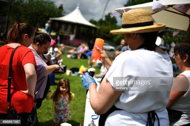A young girl recieves an ince cream as people attend a Great Get Together event in memory of murdered MP Jo Cox on June 17 2017 in Heckmondwike...