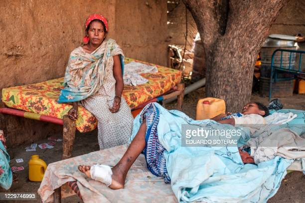 Young girl recovers from her wounds as her mother, also wonded, sits next to her, in Humera, Ethiopia, on November 22, 2020. - In her residential...