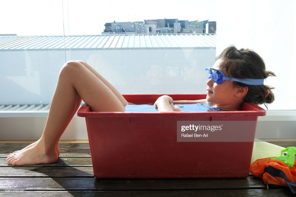 Young Girl Relaxing in Cold Water on a Hot Summer Day : Stock Photo