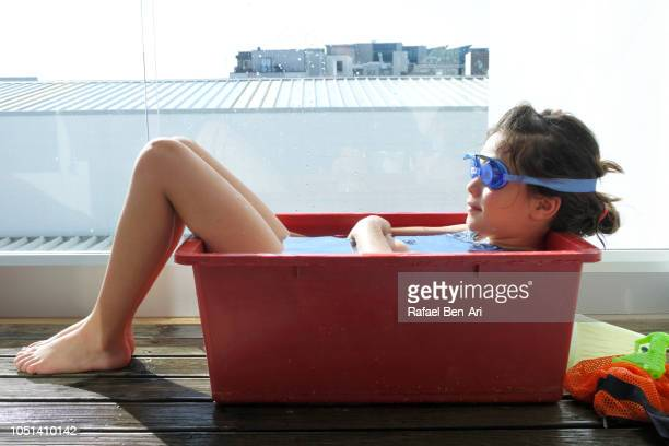 Young Girl Relaxing in Cold Water on a Hot Summer Day