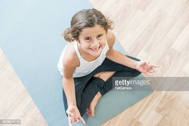 Young Girl Relaxing on the Mat