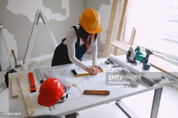 young girl renovates the house - rebuilding stock pictures, royalty-free photos & images