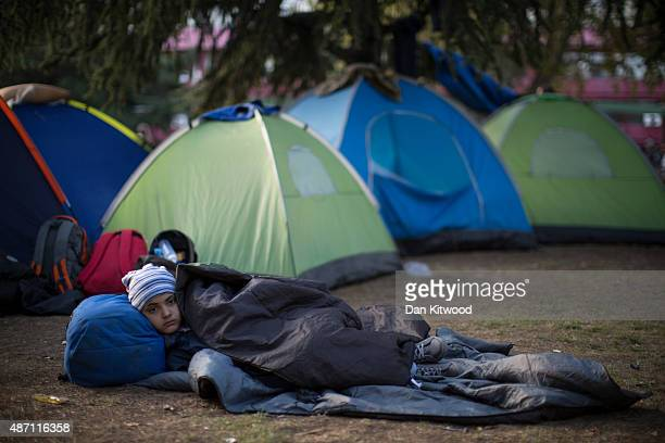 A young girl rests in a public park near the train station on September 6 2015 in Belgrade Serbia Many migrants short on financial resources and...