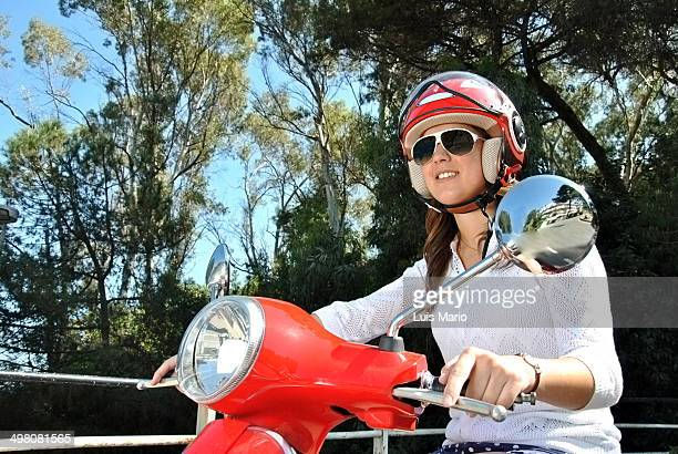 Young girl riding a moped