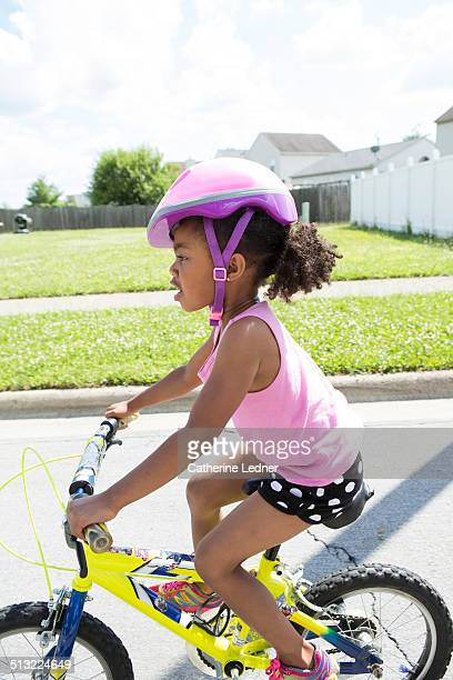 Young girl riding a two wheeled bike