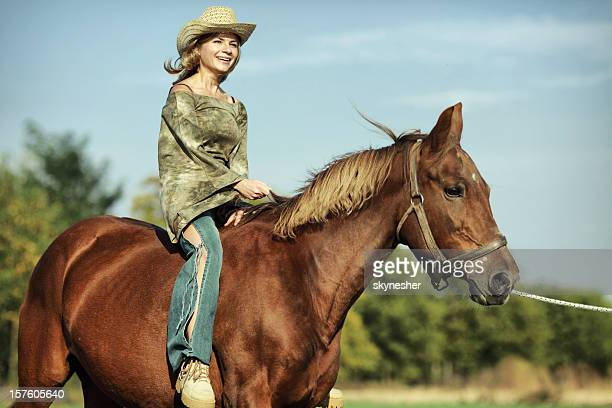 young girl riding horse in a field - girl blowing horse stock pictures, royalty-free photos & images