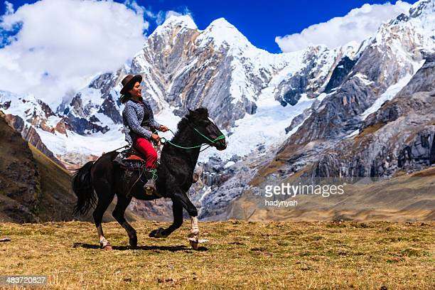 Young girl riding horse in Peruvian Andes, South America
