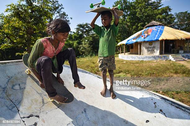 Young girl rolls on her skateboard as a boy waits for his turn at Skating Park, popularly known as Janwaar Castle, on October 26, 2016 in Janwaar,...