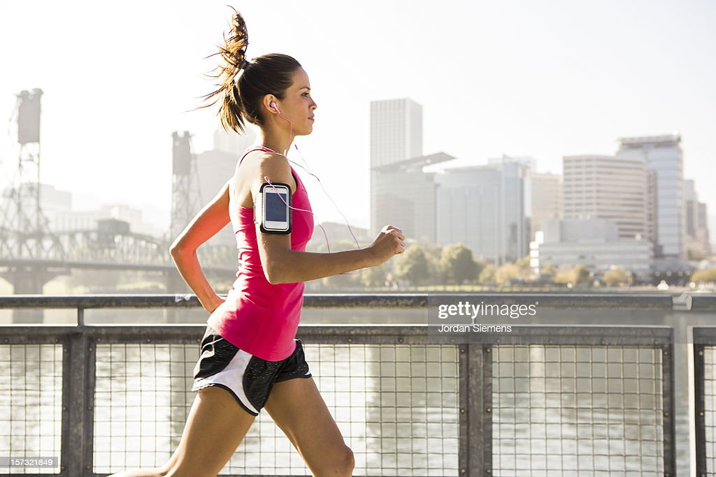 A young girl running for exercise. : Stock Photo