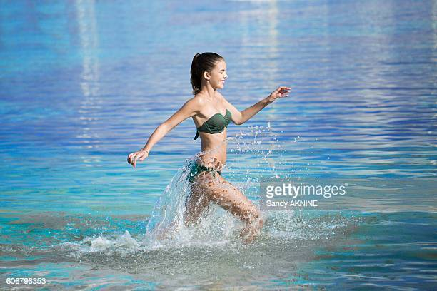 Young girl running in the sea