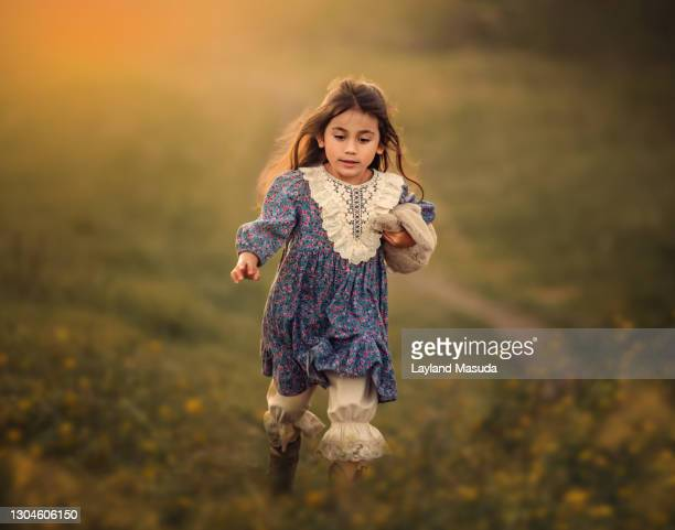 young girl running through meadow - petite fille culotte photos et images de collection