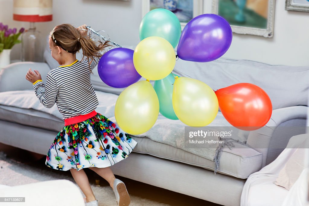 Young girl running with ballons : Stock Photo