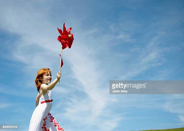 Young girl running with windmill