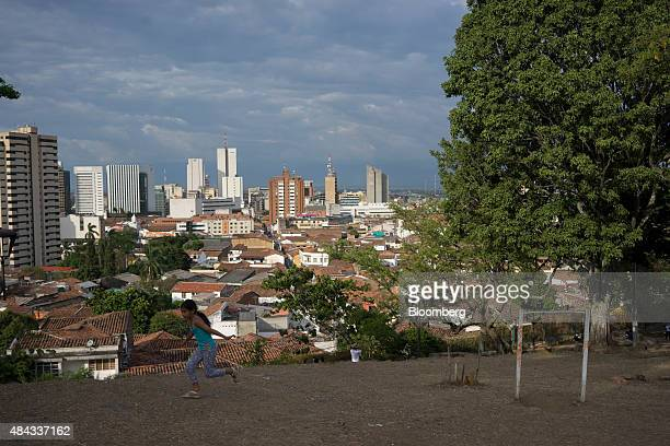 A young girl runs in the San Antonio Church Park in Cali Colombia on Wednesday Aug 12 2015 Colombia's central bank last month cut its forecast for...