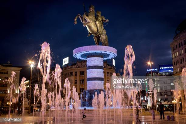 Young girl runs through a fountain in Macedonia Square on September 30, 2018 in Skopje, Macedonia. Macedonians across the country went to the polls...
