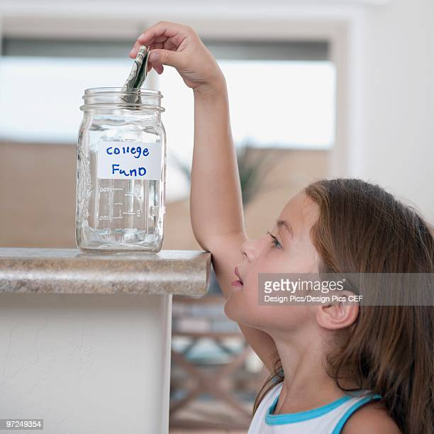 A young girl saving up for her college fund