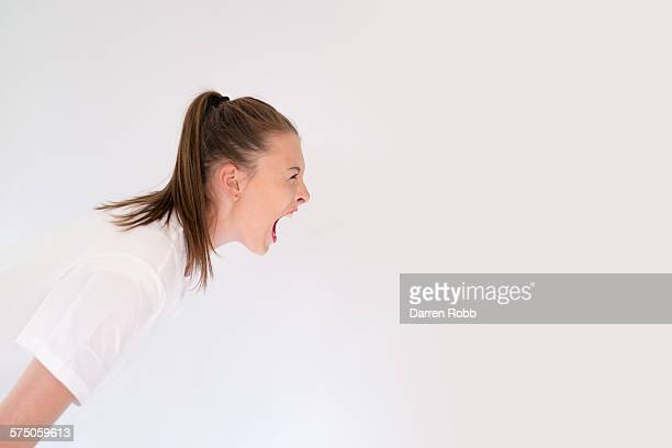 young girl screaming - anger stock pictures, royalty-free photos & images