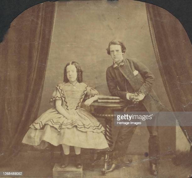 Young Girl Seated with Young Boy Leaning on Table 1860s Artist Unknown