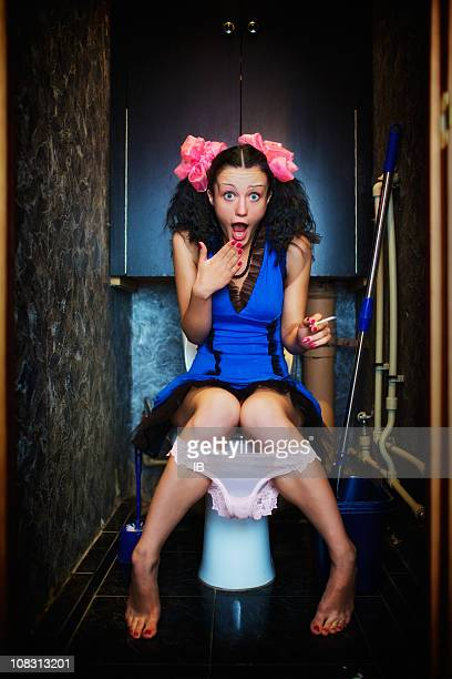 Young girl secretly smoking in toilet. But someone saw her
