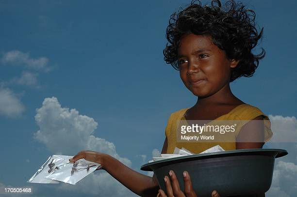 Young Girl selling shells at Cox's Bazar Sea Beach Bangladesh April 19 2006