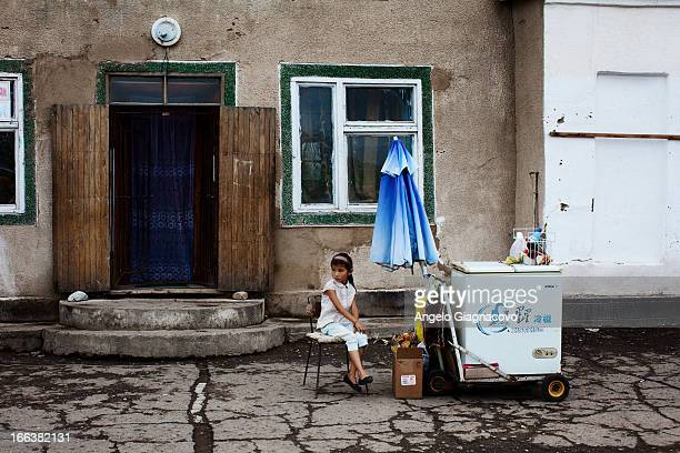 Young girl sells ice cream in the street of Karakol, Kyrgyzstan.