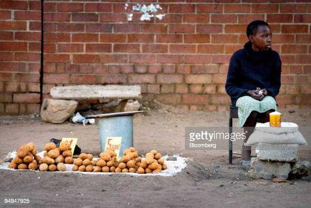 A young girl sells potatoes from a stall by the roadside using the South African Rand and US dollar in Harare Zimbabwe on Thursday April 23 2009 The...