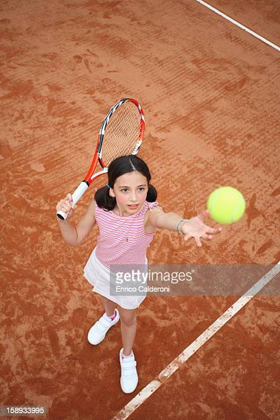 Young Girl Serve The Tennis Ball