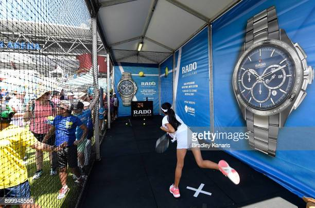 A young girl serves in one of the tennis activations during Kids Day at the 2018 Brisbane International at Pat Rafter Arena on December 31 2017 in...