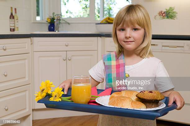 Young girl serving breakfast