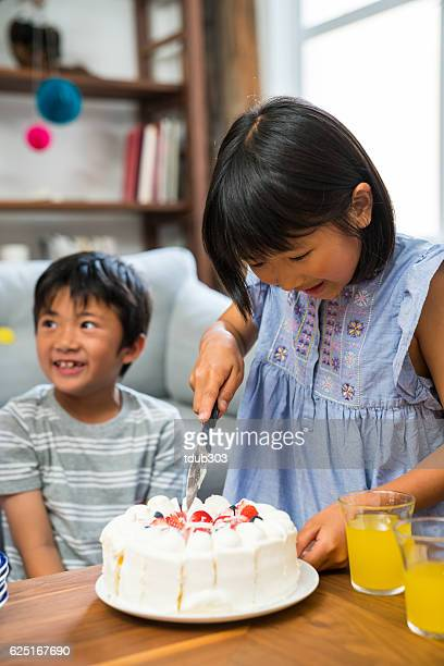 Young girl serving cake at a family celebration