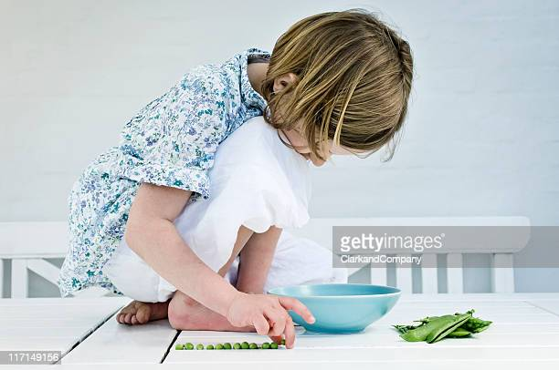 Young Girl Shelling Fresh Peas